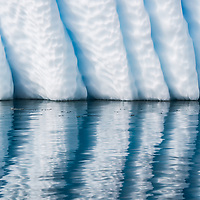 Wedge Blades - Arrowsmith Peninsula, South of Antarctic Circle<br /> <br /> Wedge iceberg that has rolled reveals these erosion marks and scalloping now on the vertical side as it drifts and cuts through the water.