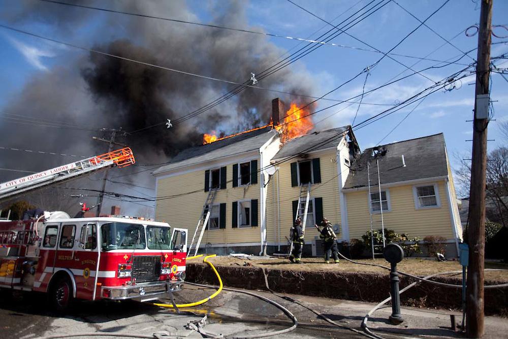 Milton, MA 03/08/2012.Companies respond to a 3 alarm house fire at 589 Adams St. in Milton on Thursday afternoon..Alex Jones / www.alexjonesphoto.com