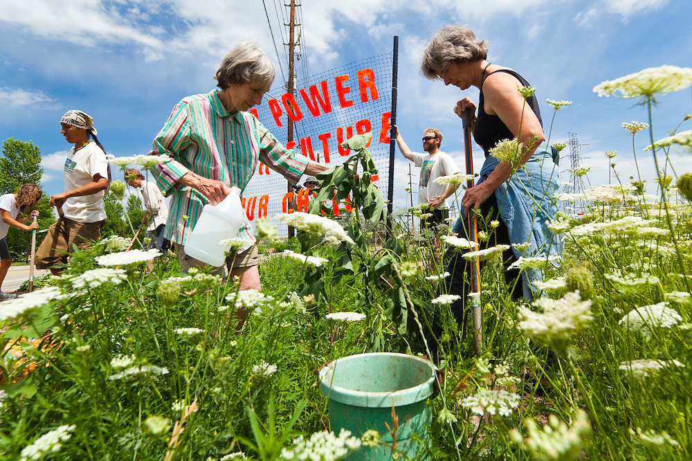 Activists plant a garden in front of the coal-fired Valmont Power Plant in Boulder, Colorado to protest its continued operation. The all-ages group reached the site by riding bicycles from downtown.