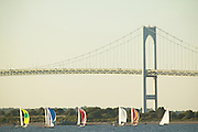 Fleet of shields races downwind in a weekly racing series by the Newport Bridge, Newport, RI