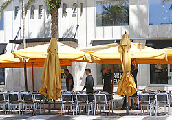 Pizza Rustica employees set up tables before opening for lunch at Lincoln Road in the Hurricane Irma aftermath on Tuesday, September 12, 2017, in Miami Beach. Photo by David Santiago/El Nuevo Herald/TNS/ABACAPRESS.COM