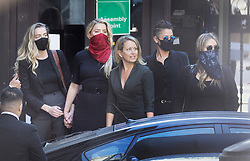 © Licensed to London News Pictures. 07/07/2020. London, UK. US actor Amber Heard (red facemask) arrives with supporters at The High Court in Central London with (L-R)Amber Heard, Australian lawyer Jennifer Robinson, Bianca Butti and unidentified. Johnny Depp's libel trial against The Sun newspaper is due to take place over the next three weeks over allegations he was violent and abusive towards his ex-wife Amber Heard. Photo credit: Peter Macdiarmid/LNP