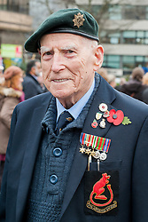 "100 years after the outbreak of world War one Veterans, Ex-servicemen Military personnel and members of the public attend the war memorial in Sheffield City centre for the two minute silence and short service as poignant an act of remembrance for those who died in the first world war.<br /> <br /> 93 year old Second world war veteran and ""Desert Rat"" Cyril Blackburn who served with Montgomery's 8th Army reads the messages on the Poppy wreaths at Sheffield War memorial<br /> <br /> 11 November 2014<br /> Image © Paul David Drabble <br /> www.pauldaviddrabble.co.uk"