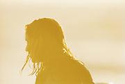 A surfer at a beach in Big Sur, California, USA