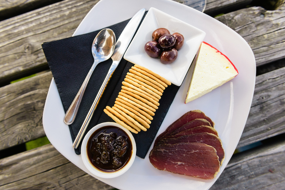 Food platter and glass of wine at Ripponlea Winery in Wanaka
