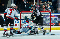 KELOWNA, BC - JANUARY 26: Roman Basran #30 of the Kelowna Rockets falls back into the net making a save on a shot from Jackson Shepard #18 of the Vancouver Giants during second period at Prospera Place on January 26, 2020 in Kelowna, Canada. (Photo by Marissa Baecker/Shoot the Breeze)