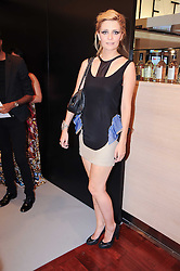 MISCHA BARTON at a party to celebrate the launch of Bang a new male fragrance by Marc Jacobs held at the Fith Floor Restaurant, Harvey Nichols, Knightsbridge, London on 22nd July 2010.