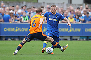 AFC Wimbledon midfielder Dean Parrett (18) taking on Oldham Athletic midfielder Dan Gardner (6) during the EFL Sky Bet League 1 match between AFC Wimbledon and Oldham Athletic at the Cherry Red Records Stadium, Kingston, England on 21 April 2018. Picture by Matthew Redman.