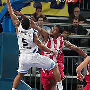 Olympiacos's Kyle Hines (R) during their Euroleague Basketball Game 7 match Fenerbahce Ulker between Olympiacos at Sinan Erdem Arena in Istanbul, Turkey, Thursday, December 01, 2011. Photo by TURKPIX