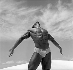 bodybuilder in briefs outdoors in White Sands National Park, New Mexico