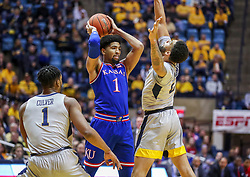 Jan 19, 2019; Morgantown, WV, USA; Kansas Jayhawks forward Dedric Lawson (1) passes while pressured by West Virginia Mountaineers forward Esa Ahmad (23) during the first half at WVU Coliseum. Mandatory Credit: Ben Queen-USA TODAY Sports