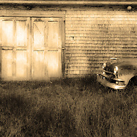 B&W version of abandoned service station in Waite, Maine with 1949 Ford sedan.