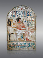 Ancient Egyptian stele of Djehutynefer called Seshu, Scribe, limestone, New Kingdom, 18th Dynasty, (1500-14253 BC), Thebes, Old Fund cat 1638. Egyptian Museum, Turin. Grey background.<br /> <br /> Djehutynefer called Seshu was the accountant scribe of cattle and fowl in the temple of Amon, and his wife the house mistress Benbu .<br /> <br /> If you prefer to buy from our ALAMY PHOTO LIBRARY  Collection visit : https://www.alamy.com/portfolio/paul-williams-funkystock/ancient-egyptian-art-artefacts.html  . Type -   Turin   - into the LOWER SEARCH WITHIN GALLERY box. Refine search by adding background colour, subject etc<br /> <br /> Visit our ANCIENT WORLD PHOTO COLLECTIONS for more photos to download or buy as wall art prints https://funkystock.photoshelter.com/gallery-collection/Ancient-World-Art-Antiquities-Historic-Sites-Pictures-Images-of/C00006u26yqSkDOM