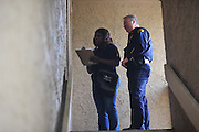 PERSON of the Dallas Police Department goes door to door as a part of the new 10/70/20 program at The Lodge at Timberglen apartments in Dallas on Saturday, March 30, 2013. (Cooper Neill/The Dallas Morning News)