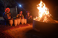MEKNES - TAFILALET, MOROCCO - CIRCA APRIL 2017: Moroccan men singing in a berber camp at night in the Sahara Desert.