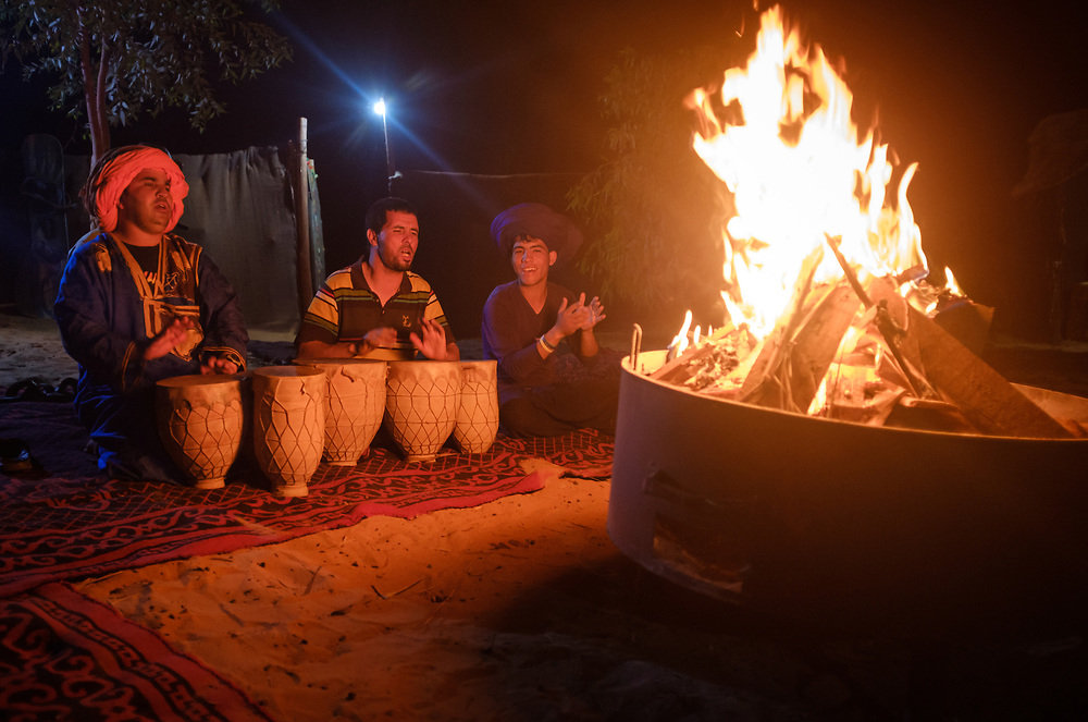 MEKNES - TAFILALET, MOROCCO - CIRCA APRIL 2017: Moroccan men singing in a berber camp at night in the Sahara Desert.