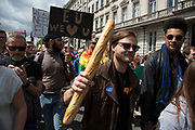 Protesters waving baguettes singing baguettes not regrets as tens of thousands of people protest in the March for Europe against Brexit demonstration following a 'Leave' result in the EU Referendum on July 2nd 2016 in London, United Kingdom. The march in the capital brings together protesters from all over the country, angry at the lies and misinformation that the Leave Campaign fed to the British people during the EU referendum. Since the vote was announced, there have been demonstrations, protests and endless political comment in all forms of media. Half of the country very displeased with the result and the prospect of being taken out of the European Union against their will, and with uncertainty as to what will happen next in the politics surrounding the exit from Europe.