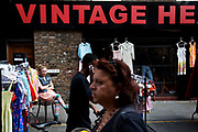 Buyers and sellers at Brick Lane for the Sunday Market. Many people come to sell their cast-off clothes and belongings to raise some cash. Official stalls selling clothers, food and all manner of crafts and junk make up the mainstay of the market though. These unofficial sellers though give the market it's unique atmosphere. This market is a weekly event in London's East End.