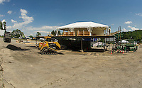 Crews work on the VIP area for Laconia Fest with the main stage being constructed later this week as set up begins for Laconia Fest at the Weirs Beach Drive In for Motorcycle Week 2016.  (Karen Bobotas/for the Laconia Daily Sun)