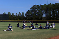 CARY, NC - FEBRUARY 23: Monmouth players stretch before the game. The Monmouth University Hawks played the Saint John's University Red Storm on February 23, 2018 on Field 2 at the USA Baseball National Training Complex in Cary, NC in a Division I College Baseball game. St John's won the game 3-0.