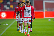 Middlesbrough players warming-up, Middlesbrough midfielder Paddy McNair (17) before the EFL Sky Bet Championship match between Brentford and Middlesbrough at Brentford Community Stadium, Brentford, England on 7 November 2020.