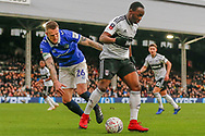 Oldham Athletic defender Peter Clarke (26) battles for possession with Fulham midfielder Neeskens Kebano (7) during The FA Cup 3rd round match between Fulham and Oldham Athletic at Craven Cottage, London, England on 6 January 2019.