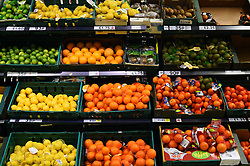 A view of limes, lemons, oranges, kiwis and tangerines in a Tesco in London.