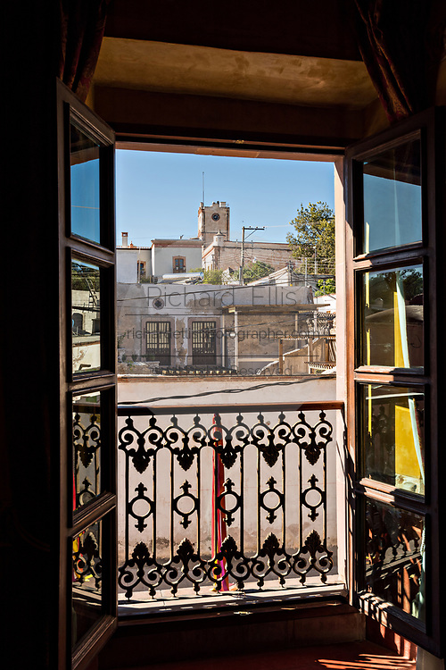 View from a window in the La Fama restaurant of the semi ghost town of Mineral de Pozos, Guanajuato, Mexico. The town, once a major silver mining center was abandoned and left to ruin but has slowly comeback to life as a bohemian arts community.