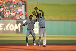 May 23, 2018 - Arlington, TX, U.S. - ARLINGTON, TX - MAY 23: New York Yankees shortstop Didi Gregorius (18) and New York Yankees third baseman Miguel Andujar (41) nearly collide to catch a fly ball during the game between the New York Yankees and the Texas Rangers on May 23, 2018 at Globe Life Park in Arlington, TX. (Photo by George Walker/Icon Sportswire) (Credit Image: © George Walker/Icon SMI via ZUMA Press)