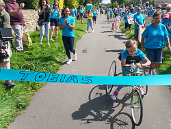 © Licensed to London News Pictures. 01/08/2020. Sheffield, UK. Tobias Weller aged 9,Sheffield completes the final 1.2km leg of his marathon in Sheffield, South Yorkshire. Nine-year-old Tobias Weller, from Sheffield, who has cerebral palsy and autism, has raised over £100,000 for Children Hospital Charity and Paces by walking a 26.2-mile marathon during the lockdown. Tobias Weller has been inspired by WWII veteran Captain Sir Thomas Moore to take his fundraising one step ahead.<br />  Photo credit: Ioannis Alexopoulos/LNP