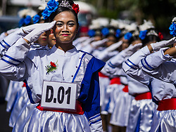 August 7, 2017 - Manggis, Bali, Indonesia - Students from schools in eastern Bali participate in an Indonesian Independence Day march in Manggis, an ocean side community in eastern Bali. Indonesian Independence Day, the country's national holiday, is celebrated on August 17. It was on that date in 1945 that Sukarno signed Indonesia's proclamation of independence from the Netherlands. It was the beginning of a four year war for independence. The Dutch didn't officially grant Indonesia independence until December, 1949. The day is celebrated with parades and enthusiastic displays of patriotism throughout the country. (Credit Image: © Jack Kurtz via ZUMA Wire)
