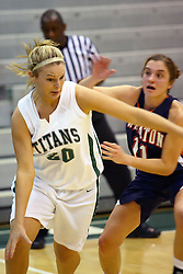 10 January 2009: Holly Harvey breaks past Noelle Dryden. The Lady Titans of Illinois Wesleyan University downed the and Lady Thunder of Wheaton College by a score of 101 - 57 in the Shirk Center on the Illinois Wesleyan Campus in Bloomington Illinois.