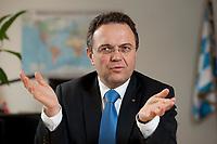 03 JAN 2011, BERLIN/GERMANY:<br /> Hans-Peter Friedrich, MdB, CSU, Vorsitzender der CSU Landesgruppe im Deutschen Bundestag, waehrend einem Interview, in seinem Buero, Jakob-Kaiser-Haus, Deutscher Bundestag<br /> IMAGE: 20110103-01-007
