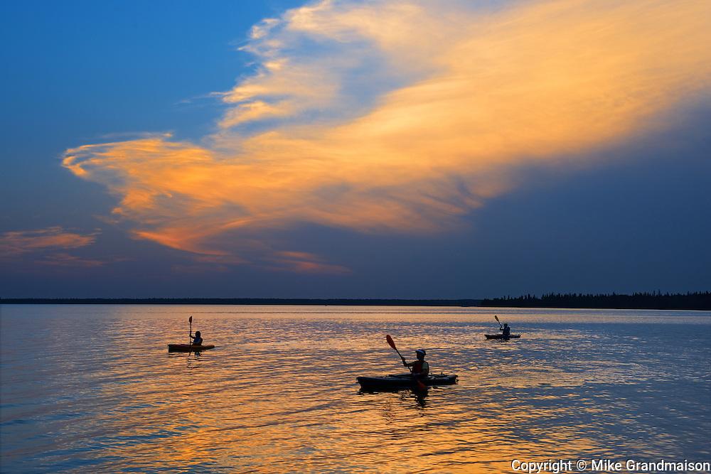 Kayaking on Clear Lake at sunset. Riding Mountain National Park, Manitoba