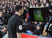 Football - 2019 / 2020 Premier League - Crystal Palace vs. Sheffield United<br /> <br /> Referee, Andy Madey checks VAR for a possible red card decision, at Selhurst Park.<br /> <br /> COLORSPORT/ANDREW COWIE