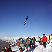 Athletes arrive at the competition site via helicopter transportation during the World Heli Challenge Freestyle Day at Mount Albert on Minaret Station, Wanaka, New Zealand. 31st July 2011