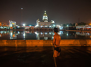 New Delhi, India: A young man takes his purification bath at the preparations for the celebrations of Guru Nanak Dev at the Sikh Temple Bangla Sahib in New Delhi.<br /> <br /> HOW TO LICENCE THIS PICTURE: please contact us via e-mail at simon.padovani@gmail.com or call +39 3921454211 for prices and terms of copyright. First Use Only ,Editorial Use Only, All repros payable, No Archiving. ©Simone Padovani
