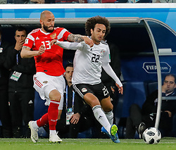 June 19, 2018 - Saint Petersburg, Russia - Fedor Kudriashov (L) of Russia national team and Amr Warda of Egypt national team vie for the ball during the 2018 FIFA World Cup Russia group A match between Russia and Egypt on June 19, 2018 at Saint Petersburg Stadium in Saint Petersburg, Russia. (Credit Image: © Mike Kireev/NurPhoto via ZUMA Press)