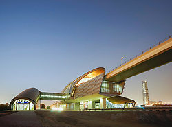 Modern metro railway station at night in Dubai United Arab Emirates