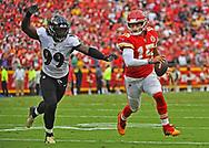 Outside linebacker Matt Judon #99 of the Baltimore Ravens scrambles after quarterback Patrick Mahomes #15 of the Kansas City Chiefs, during the second half at Arrowhead Stadium on September 22, 2019 in Kansas City, Missouri.