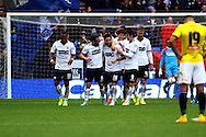 Bolton Wanderers' Mark Davies (c) celebrates with his teammates after scoring his teams 2nd goal. Skybet football league championship match, Bolton Wanderers v Brentford at the Macron stadium in Bolton, Lancs on Saturday 25th October 2014.<br /> pic by Chris Stading, Andrew Orchard sports photography.