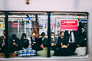 every day Street scene in Japan Passengers onboard a train