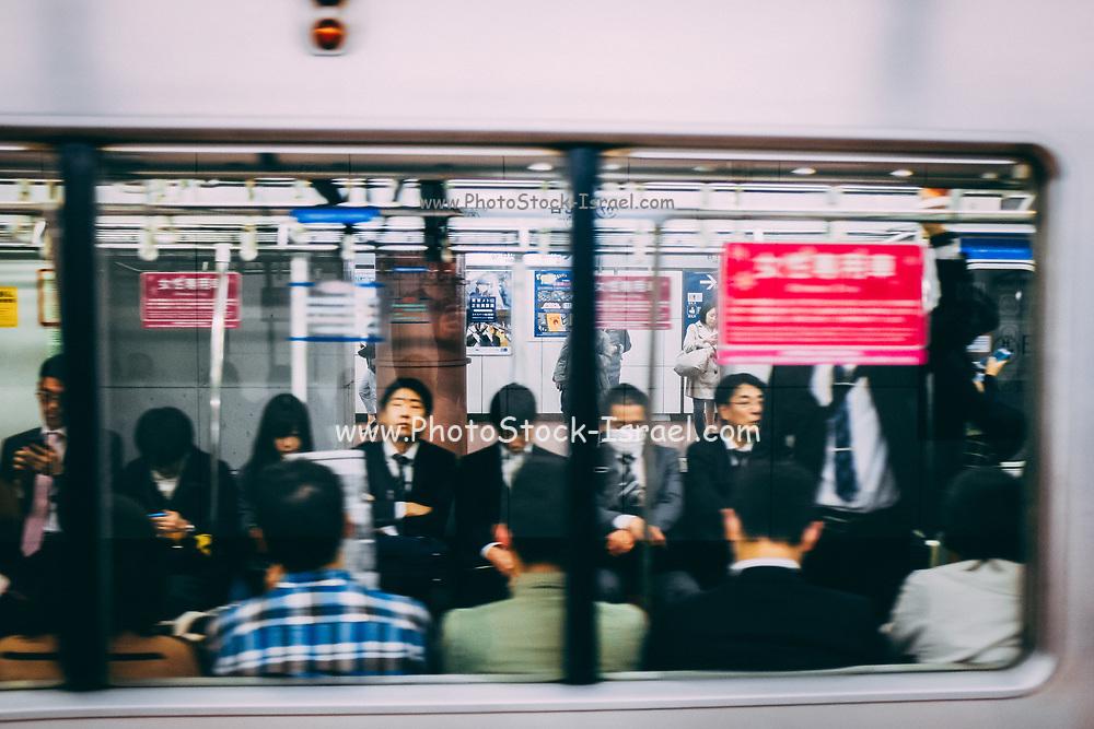 every day Street scene in Japan Passengers onboard a train