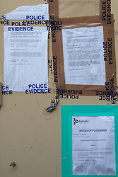 A notice of possession and an antisocial behaviour order are attached to the boarded up door of a flat where neighbours say a drug den was operating. An elephant topiary hedge at the corner of Ambler and Romilly Roads in Finsbury Park, much beloved of local residents, is under threat after it has been claimed that drug users are using the cover of the elephants. The ground floor flat at the address has been boarded up following a police raid and eviction of tenants who, according to neighbours, were using the flat as a drugs den . London, August 12 2019.