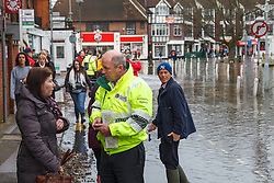 © Licensed to London News Pictures. 10/02/2014. Datchet, Berkshire, UK. The Environment Agency speaking to local residents. Flooding in Datchet today, 10th February 2014 after the River Thames burst its banks. Photo credit : Rob Arnold/LNP