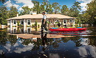 April Thomas makes the trek to her house to check on the flood damage in Conway, S.C., almost two weeks after Hurricane Florence hit, on Wednesday, Sept. 26, 2018