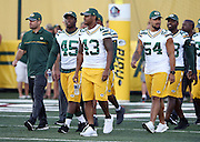 Green Bay Packers rookie linebacker Manoa Pikula (45), Green Bay Packers rookie outside linebacker Beniquez Brown (43), and Green Bay Packers outside linebacker Carl Bradford (54) lead the team onto the field just before the announcement canceling the Green Bay Packers 2016 NFL Pro Football Hall of Fame preseason football game against the Indianapolis Colts on Sunday, Aug. 7, 2016 in Canton, Ohio. The game was canceled for player safety reasons due to the condition of the paint on the turf field. (©Paul Anthony Spinelli)