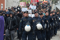 Licensed to London News Pictures. 15/11/2015. Spielfeld, Austria. Anti-migrant protest in Spielfeld, Austria. Several hundred rally against migrants at Austria's border with Slovenia. Protest Against Nazi march and Fortress Europe. Photo: Marko Vanovsek/LNP