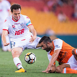 BRISBANE, AUSTRALIA - OCTOBER 13: Isaias of Adelaide is tackled by Fahid Ben Khalfallah of the Roar during the Round 2 Hyundai A-League match between Brisbane Roar and Adelaide United on October 13, 2017 in Brisbane, Australia. (Photo by Patrick Kearney)