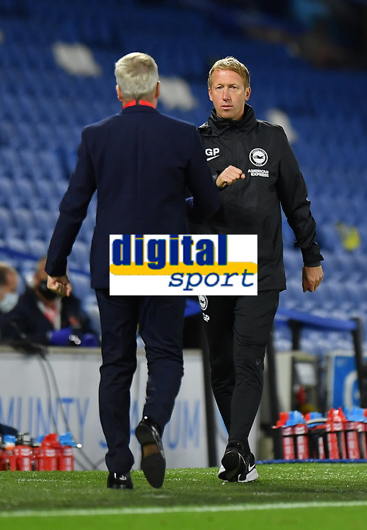 Football - 2020 / 2021 EFL Cup - Round Two - Brighton & Hove Albion vs Portsmouth<br /> <br /> Brighton & Hove Albion Head Coach Graham Potter with Portsmouth manager Kenny Jackett at the final whistle, at the Amex Stadium.<br /> <br /> COLORSPORT/ASHLEY WESTERN
